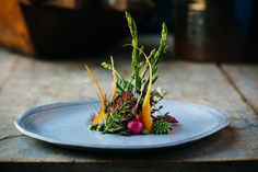 Grilled Asparagus With Buttermilk Panna Cotta, Garden Vegetables, and Paddlefish Roe.  Blackberry Farm, Walland, Tennessee. Photo: Shawn Poynter