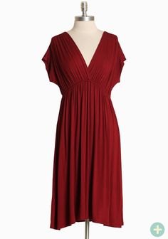 "Loudoun Curvy Plus Cinched Dress 34.99 at shopruche.com. This incredibly soft maroon frock is perfected with a feminine v-neckline and delicate ruching for interest and texture. Finished with a defining elasticized waist and a hint of stretch for a flattering and comfortable fit.  95% Rayon, 5% Spandex, Made in USA, 42"" length from top of shoulder"