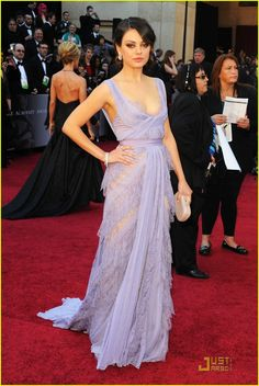 Mila Kunis in Elie Saab Haute Couture at the 2011 Oscars. It's very swan-like and I love the color. She looked great.