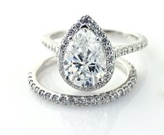 Moissanite pear shaped engagement ring and wedding band