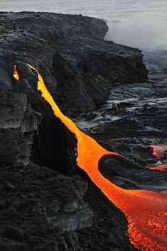 River of molten lava from Kilauea volcano flowing into the sea. Hawaii Volcanoes National Park, The Big Island of Hawaii. #lava #volcano #hawaii