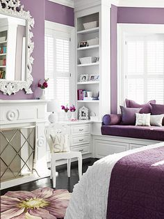 high-gloss white molding and an ornate painted mirror. Darker shades of plum show up on linens, giving the mauve an up-to-the-minute flair