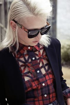 Preppy Punk Chic. Cut-out on plaid with a sleek black blazer.