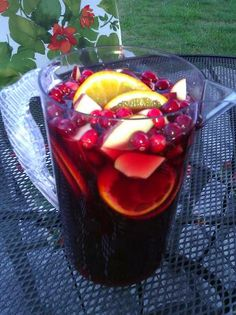 Jolly Cranberry Juice Sangria. - Ingredients: 1 bottle of Zinfandel,  4 cups Cranberry Juice, 1 cup Orange Juice, 1 Orange, 1 Apple, 1/2 cup fresh Cranberries.