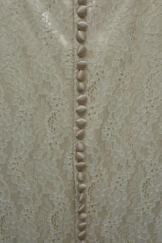 Buttons running down the back of a wedding dress worn in 1944. Collection: Royal Pump Room/Harrogate Museums.