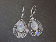 Made with moonstone cabochons and faceted stones and sterling silver with leverback earring wires.