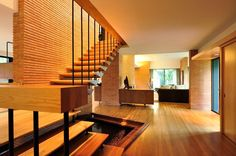 The warm tones of a foyer in a home located in the Greenway Parks neighborhood of Dallas, Texas. Designed by Howard Meyer it was completed 1951.