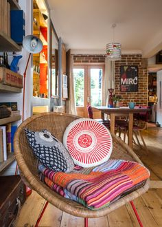 Shauna & John's Post Punk Eclectic English Home and Artist's Studio LOVE Love love the chair and cant and pillows !!