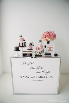 So chic! Coco Chanel themed dessert table with black and pink details