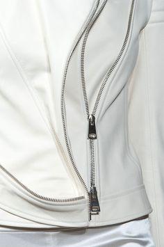 White leather jacket with decorative zipper trim; fashion details // Bouchra Jarrar