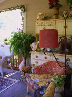 I have an old Hoosier Cabinet to use on my back porch.  Love the colors and lamps