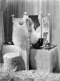 """Jean Harlow in her fringe-fantasy boudoir for """"Dinner at Eight:, It was a marked moment for ultra-glamorous white interiors. Jean Harlow, Old Hollywood Glamour, Classic Hollywood, Hollywood Regency, Hollywood Icons, Vintage Hollywood, Hollywood Stars, Marilyn Monroe, Movie Bedroom"""