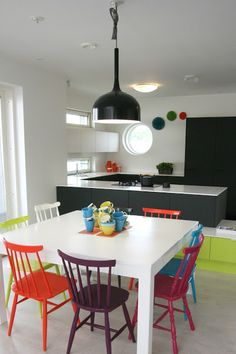 colorful chairs around a solid table. (prefer it round, but this works too)