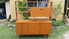 Stylish and useful timber veneer wall unit & cocktail bar & room divider, in overall good used condition. There is a small chip on one bottom front corner, and on the corresponding bottom corner of the door on that side. Mid Century Wall Unit, Outdoor Furniture, Outdoor Decor, Retro Vintage, Lounge, The Unit, Stylish, Divider, Corner