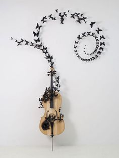 Fable (2011) is a poetic sculpture composed of a cello, recycled-aluminum butterflies, wire, and soot, by sculptor and installation artist Paul Villinski.