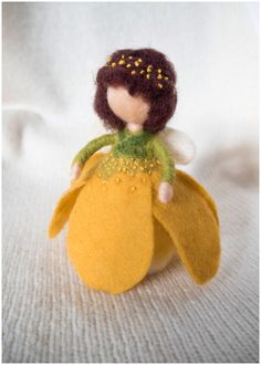 Needle Felted Waldorf Wool Fairy. Yellow Flower Fairy by ToysFromDreams on Etsy https://www.etsy.com/ca/listing/270664684/needle-felted-waldorf-wool-fairy-yellow