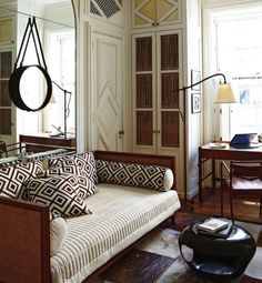 Captain's Mirror, daybed, graphic prints, great nook to an office. (A New York City Apartment by Robert Couturier)