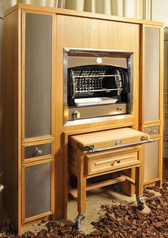 Brown Enameled Flamberge Set In La Cornue Cabinetry With Butcher Block