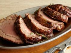 Roast Prime Rib with Thyme Au Jus1 bone-in prime rib (6 to 7 pounds) 8 cloves garlic, thinly sliced Salt and coarsely ground black pepper 2 cups red wine 4 cups beef stock 1 tablespoon chopped fresh thyme leaves