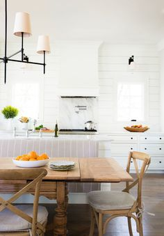 Love how clean this kitchen looks - simple lighting and lots of drawers. Not a huge fan of shiplap.