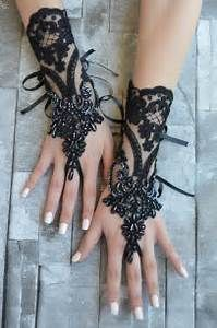 med length black lace fingerless bridal gloves for a goth, victorian or steampunk wedding.