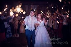 Guests and newlyweds with sparklers in garden at Bournemouth Hotel Wedding. Photography by one thousand words wedding photographers