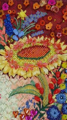 Tuscan Heart from Melissa Shirley Designs. Stitched by Carolyn Hedge Baird, and she offers a stitch guide.  This is close up of the sunflower. Beautiful ribbon work and beading!