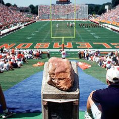 """Clemson's Howard's Rock  Clemson Tigers refuse to run down The Hill above Memorial Stadium until they've rubbed Howard's Rock, the mojo-giving stone placed there a half-century ago by legendary coach Frank Howard. """"Give me 110%,"""" he told his team, """"or keep your filthy hands off my rock!"""" Coach Hootie Ingram once stopped the tradition, but, after losing 9 of his next 15 home games, brought it back."""
