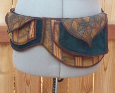 Check out this item in my Etsy shop https://www.etsy.com/listing/224841575/geometric-teal-and-brown-pocket-belt