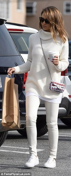 Busy bee: Jessica walked away with a shopping bag and her coffee in hand...