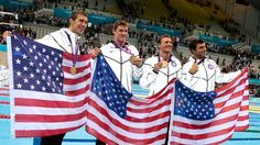 The USA men's 4 x 200m Freestyle Relay team. Michael Phelps, Conor Dwyer, Ryan Lochte and Ricky Berens pose with the Gold Medals they won.