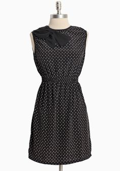 """Time Stands Still Patterned Dress 39.99 at shopruche.com. This silky black dress is crafted with charming feminine  details, a playful white heart print, and an elasticized waistline for a flattering fit. Back button keyhole closure. Lightweight.Self: 100% Polyester, Contrast: 95% Polyester, 5% Spandex, 31.5"""" length from top of shoulder"""