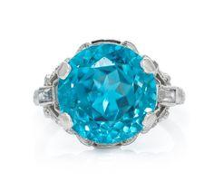 An Art Deco Platinum, Blue Zircon, White Sapphire and Diamond Ring.