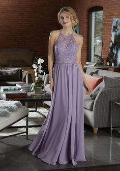 Shop Morilee's Modern and Sophisticated Chiffon Bridesmaid Dress.  Chiffon Bridesmaid Dress Featuring a High Neck, Net Bodice Accented in Beaded Embroidery. A Flowy Chiffon Skirt and Beaded Strappy Back Complete the Look. View the Chiffon Swatch Card for Color Options. Shown in French Lilac.