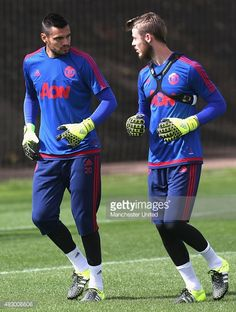 Sergio Romero and David de Gea of Manchester United in action during a first team training session