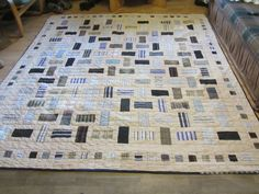 Scrappy quilt from shirts and sheet. Really like this one.