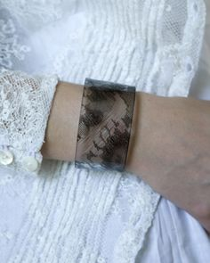 vintage black lace cuff from nonesuch things :) I think this would be easy to make.