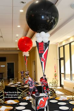 Hockey Themed Centerpiece Hockey Themed Centerpiece with Cutout Player & Floating Pennants