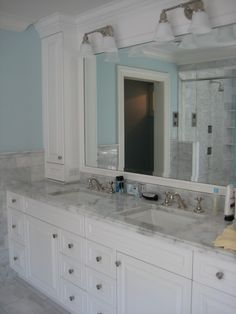 Carrara marble tile and counter with every option available, from Kohler fixtures to frameless shower doors.