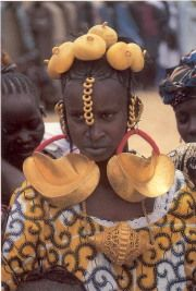 Africa   A Peul woman wearing traditional jewellery and 'African' amber beads in her hair.  Mali
