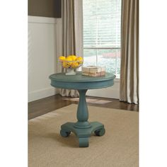 This cute accent table brings traditional style and bright color to your home with classic scrolled feet in a gently distressed, vintage soft blue finish. Cece Accent Table   Weekends Only Furniture and Mattress