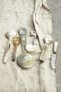 Carved shell spoons are used for caviar, which shouldn't be touched by metal.