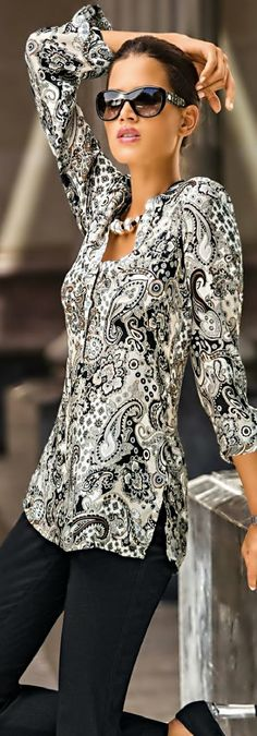 Love everything about this tunic. The print and the style are great for dressing up or down