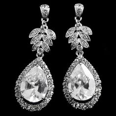 Vintage starlet earrings with a vintage vibe – stunning design with clear crystals on a silver tone finish – measures by Teardrop Earrings, Crystal Earrings, Diamond Earrings, Vintage Jewelry, Unique Jewelry, Crystal Wedding, Wedding Earrings, Chandelier Earrings, Jewelry Shop