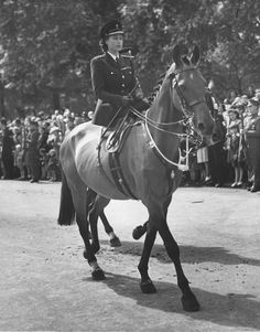 Queen Elizabeth riding sidesaddle like a pro