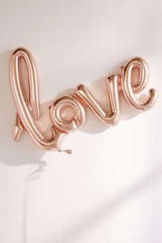 'LOVE' rose gold balloon banner for fun party decorations. (affiliate link)