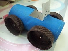 A Little Learning For Two: Cardboard Tube Car We modified this with mini paper cups and brads for wheels. Much quicker easier and better than nails for 4 year old.