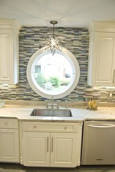 I love the circle window over the sink, as well as the star light fixture. So pretty.