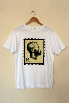 The 'R' Reign Of Rakim Stamp Tee  available from http://shop.madina.co.uk