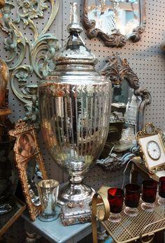 Large mercury glass urn.